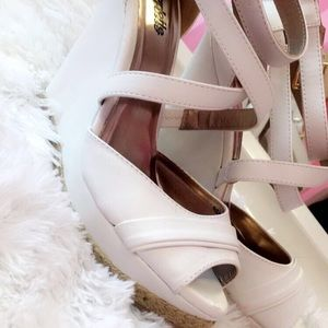 White high heeled wedges.